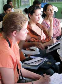Learning Opportunity. Inset, USA TODAY reporter Sharon Carty, WMBC-TV reporter Nicole Israel, and Times of India reporter Rukmini Shrinivasan listen as nonprofit leaders discuss how they assist residents of Dharavi slum.