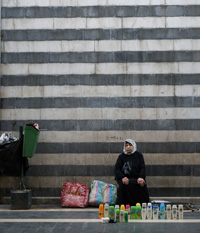 Small Business. A woman sells shampoo on a Damascus street. Escaping isolation is a key to reviving Syria's slumping economy.
