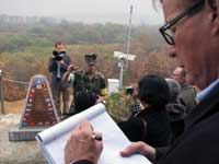 Gaining Insight. Mike Mosettig, producer for foreign affairs and defense with The NewsHour with Jim Lehrer on PBS, takes notes at the demilitarized zone between South and North Korea.