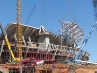 Welcoming the World. One of several new stadiums needed for South Africa's hosting of the 2010 World Cup rises near Johannesburg.