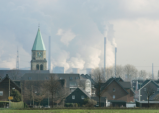 The coal-fired power station fed by the mine Prosper-Haniel spews emissions into the air on February 6, 2007, in Bottrop, Germany. Prosper-Haniel, one of the two last hard-coal mines in Germany, is scheduled to close in 2018. Ahead of that closure, a consortium of local universities, consultants, and mining operators is exploring the chance to turn the plant's deep mine shaft into a hydroelectric storage facility.