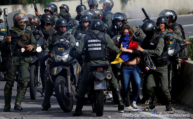 A demonstrator is detained by security forces on July 10, 2017, during a protest against Venezuelan President Nicolas Maduro's government in Caracas, Venezuela. People have been demonstrating in the streets in opposition to the government almost daily since March. Scores have died in clashes with security forces.