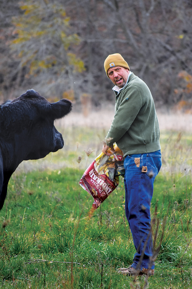 Seth Watkins feeds his cattle on November 1, 2017, at his farm near Clarinda, Iowa. Watkins has about 600 beef cattle, owns about 400 acres, and rents about 2,800 acres, mostly pastureland.
