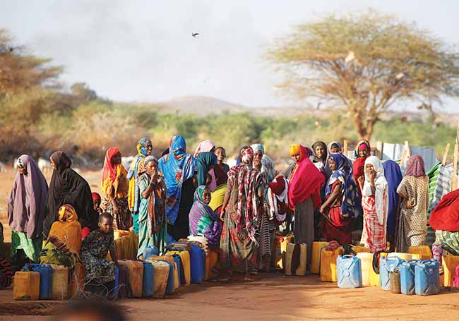 Somali women wait to collect water February 25, 2018, at the New Kabasa internally displaced camp in Dollow, Somalia. The UN Security Council, in its resolution last March to extend the mandate of the UN mission in Somalia, included a rare reference to climate change.