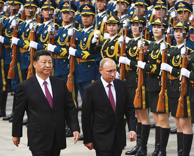 Chinese President Xi Jinping hosts a welcoming ceremony for Russian President Vladimir Putin on May 20, 2014, in Shanghai. If the United States abandons its role in multilateral leadership, other countries like China may step in to fill the void.