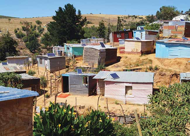 Many of the residents of the slum Enkanini, in the town of Stellenbosch, South Africa, have solar panels on their dwellings, thanks to Stellenbosch University's iShack project. The solar home systems are partly subsidized by the municipality of Stellenbosch.