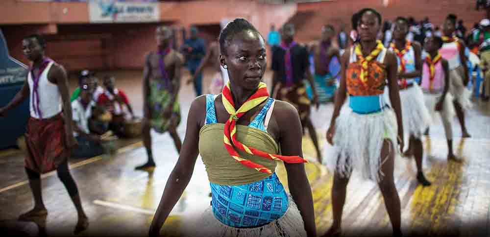 Scouts perform a dance routine on August 11 during a youth event in Bangui, CAR. A Girl Scout troop of about 50 young women has been founded in Bangui. Girls in Bangui, and even more so in the rest of the country, have fewer options than boys for employment and recreation.