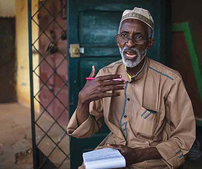 Ali Ousman, coordinator of the Muslim civil society coalition, speaks to visitors on August 12, 2018, in the PK5 neighborhood of Bangui, CAR.