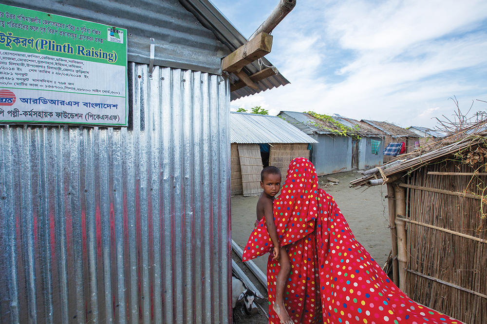 The river islands of Bangladesh are prone to frequent flooding, a result of global warming. To survive, island residents in the Kurigram district build their homes on mobile raised platforms, an adaptation project supported by the Bangladeshi, Australian, and British governments.