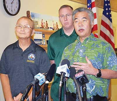 Hawaii Governor David Ige (right) speaks to reporters in Honolulu on January 13, 2018, after a false missile alert was sent by the state's Emergency Management Agency. Ige blamed human error.