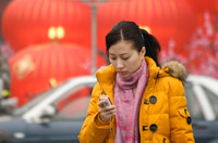 China Calling. A Chinese woman checks her mobile phone in Shanghai, China. Millions of Chinese have entered the middle class as growing exports supported new manufacturing jobs. While China remains the only one of the world's five biggest economies still growing, many jobs have been lost in the wake of the world economic crisis.