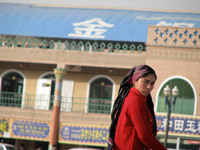 Oppression. Uighur woman walks past the Id Kah Mosque in Kashgar, the largest mosque in China where limits are placed on how the local Muslim population can worship. Moderate Central Asian Muslims like the Uighurs could play a cooperative role in the fight against terrorism but China's repressive policies threaten to inspire new extremists.