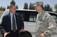 A State Department official and an Air Force Colonel meet at an air base in Kyrgyzstan. The United States needs the right mix of civilian and military presence around the world.
