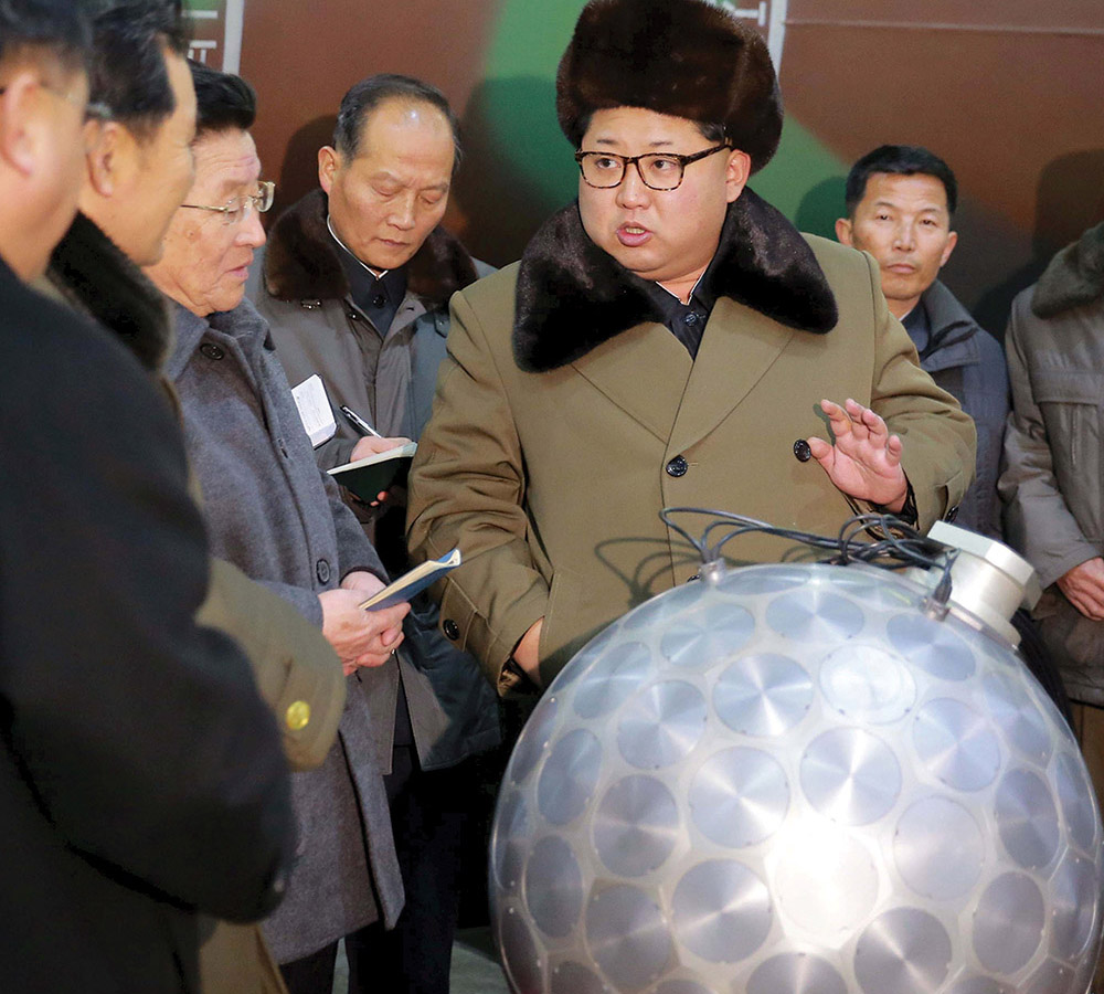 North Korean leader Kim Jong Un meets nuclear scientists and technicians in this undated photo released by North Korea's Korean Central News Agency. A similar photo served as an important reference for author Melissa Hanham.
